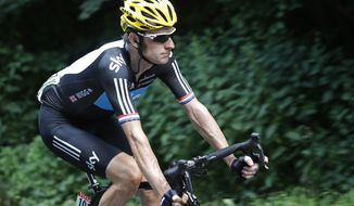 New overall leader Bradley Wiggins rides during the seventh stage of the Tour de France over 199 kilometers (123.6 miles) with start in Tomblaine and finish in La Planche des Belles Filles, France, on Saturday July 7, 2012. (AP Photo/Laurent Cipriani)