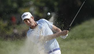 Webb Simpson hits out of the bunker on the 17th hole during the third round of the Greenbrier Classic PGA Golf tournament at the Greenbrier in White Sulphur Springs, W.Va., Saturday, July 7, 2012. Simpson shot a 5-under-65 leaving him in the lead at 14-under for the three rounds. (AP Photo/Steve Helber)