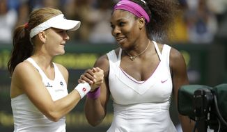 Serena Williams of the United States, right, is congratulated by Agnieszka Radwanska of Poland after winning the women's final match at the All England Lawn Tennis Championships at Wimbledon, England, Saturday, July 7, 2012. (AP Photo/Alastair Grant)