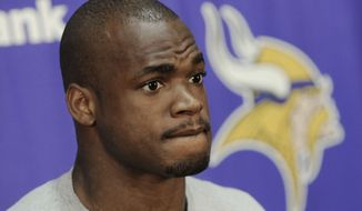 Minnesota Vikings running back Adrian Peterson was arrested Saturday on a charge of resisting arrest. (AP Photo/Jim Mone)