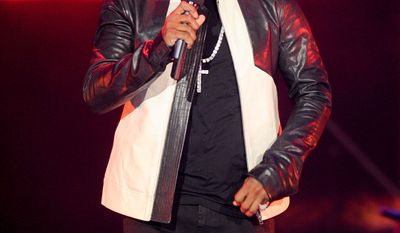 """Hip-hop entrepreneur Sean """"P. Diddy"""" Combs' home was broken into by Quamine Taylor, who was sentenced Thursday to time served for the offense. (Associated Press)"""