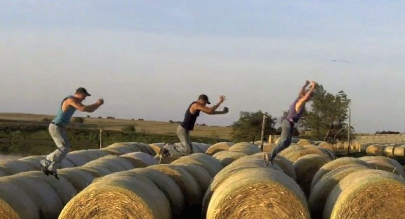 "Nathan, Kendal and Greg Peterson (from left) are shown in their video parody titled ""I'm Farming and I Grow It."" The parody, which has gone viral on YouTube and Facebook, shows the three brothers rapping about farming on the family farm in central Kansas. Greg Peterson came up with the idea from the LMFAO song ""Sexy and I Know It."" (Greg Peterson via Associated Press)"