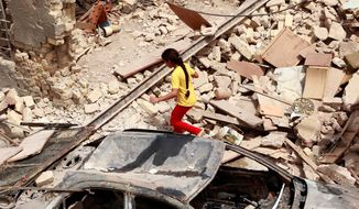 Zainab Abbas inspects her destroyed house June 29, one day after a car bomb attack in the Washash neighborhood of Baghdad. June was the second-deadliest month in Iraq since U.S. troops pulled out Dec. 18, 2011, with a major bombing or shooting occurring about twice a week. The possibility of civil war is a concern. (Associated Press)