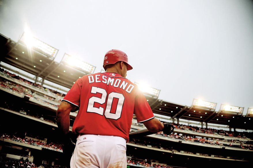 "Says Nationals shortstop Ian Desmond: ""As long as I have a jersey on my back, I'll be happy,"" Desmond said. ""I think if it's a Washington Nationals jersey, I'll be happier."" (Ryan M.L. Young/The Washington Times)"
