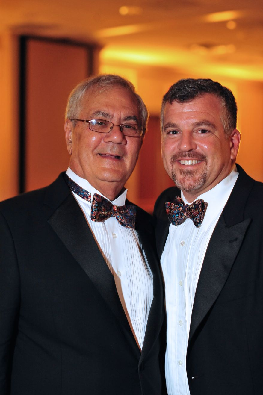 Rep. Barney Frank (left), Massachusetts Democrat, and Jim Ready pose July 7, 2012, at their wedding reception. Frank married his longtime partner in a ceremony officiated by Massachusetts Gov. Deval Patrick in Newton, Mass. (Associated Press/Fotique, Jaime E. Connolly)