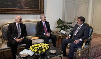 Egyptian President Mohammed Morsi (right) meets July 8, 2012, with Foreign Minister Mohammed Kamel Amr (left) and U.S. Undersecretary of State William Burns at the Presidential palace in Cairo. Morsi is the country's first democratically-elected president, first Islamist, and civilian to take office in Egypt. (Associated Press/Maya Alleruzzo)