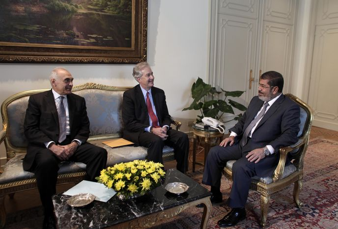 Egyptian President Mohammed Morsi (right) meets July 8, 2012, with Foreign Minister Mohammed Kamel Amr (left) and U.S. Undersecretary of State William Burns at the Presidential palace in Cairo. Morsi is the country's first democratically-elected president, first I