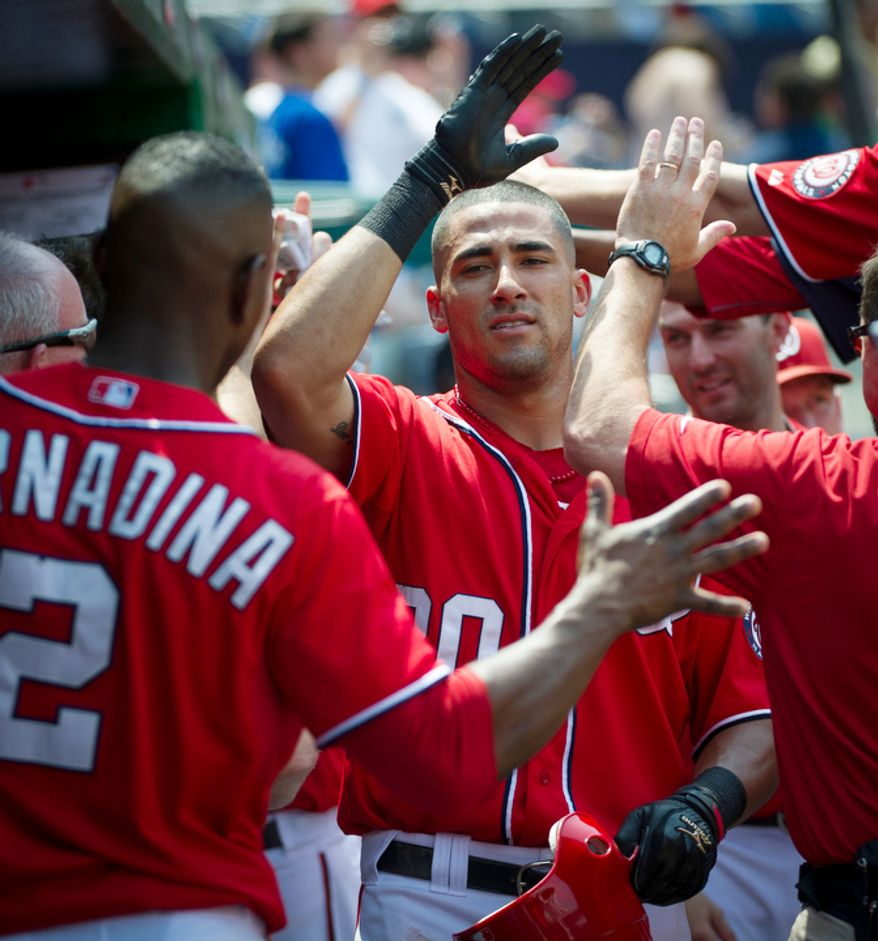 Nationals Ian Desmond is greeted by team mates in the dugout after his two-run home run. (Rod Lamkey Jr./The Washington Times)