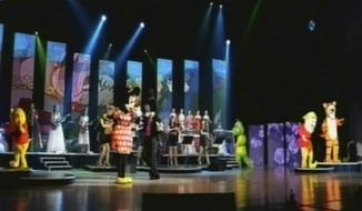 In this image made off North Korea's KRT video footage, North Korea's new Moranbong band and performers dressed as American cartoon characters perform July 6, 2012, in Pyongyang, North Korea. Mickey Mouse and Winnie the Pooh took the stage for new leader Kim Jong-un, in an unusual performance featuring Disney characters in North Korea. (Associated Press/KRT)