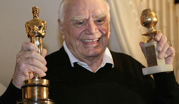 "**FILE** Actor Ernest Borgnine displays his Golden Globe (right) and Academy awards he received in 1956 for the movie ""Marty"" in Beverly Hills, Calif., on Jan. 13, 2008. (Associated Press"