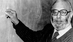 """**FILE** Abdus Salam, Pakistan's only Nobel laureate, is seen here on Oct 15, 1979, in London after receiving the news that he was joint winner of that year's Nobel Prize for physics. Salam, who belongs to a minority Muslim sect, helped develop the theoretical framework that led physicists to discover the """"God particle,"""" is not celebrated by his country and schoolchildren are rarely even taught his name. (Associated Press)"""