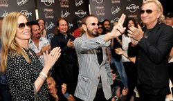 Musician Ringo Starr (center) celebrates his 72nd birthday on July 7, 2012, with his wife Barbara Bach (left) and musician Joe Walsh (right) at the Hard Rock Cafe in Nashville, Tenn. (Associated Press/Rob Shanahan)
