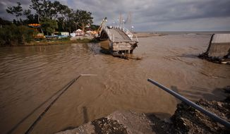 A bridge is destroyed by flooding July 7, 2012, in the Black Sea resort of Gelendzhik in southern Russia. Torrential rains dropped nearly a foot of water in the Black Sea region overnight, unleashing intense flooding that killed more than one hundred people and forced many to seek refuge in trees and on roofs, officials said. (Associated Press)