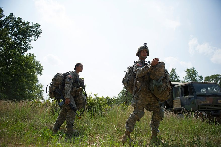 Sapper candidate and Army Captain Stephanie Godman (left) and the rest of the platoon make their way to a waiting truck to be transported to a site for the next mission during another day of Sapper School training at U.S. Army Maneuver Support Center (MANSCEN) and Fort Leonard Wood in Fort Leonard Wood, Mo., Monday, June 25, 2012. (Rod Lamkey Jr./The Washington Times)