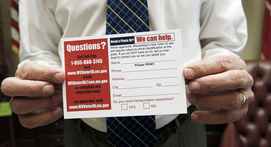 **FILE** Mississippi Secretary of State Delbert Hosemann holds a postcard to help identify voters in need of a free state-government issued card on June 19, 2012. The card will be issued through his office in Jackson, Miss., at no charge. (Associated Press)