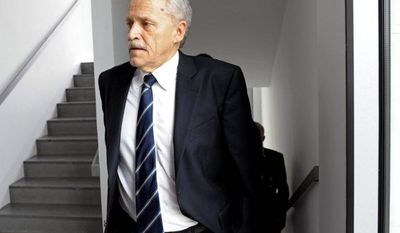 Departed president of the German domestic spy service, Heinz Fromm, arrives to be quizzed by a parliamentary investigation committee in Berlin on Thursday about the failure of the spy agency to detect a small neo-Nazi group operating in Germany. (Associated Press)