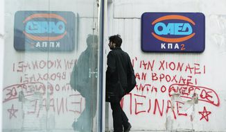 "A young man enters an office of the Labor Force Employment Organization, with graffiti under the logo of OAED reading ''Snow or rain the jobless are always hungry'' in Athens. Economists fear that years of unemployment could produce a European version of Japan's ""Lost Generation,"" the young jobless adults of the 1990s. (Associated Press)"