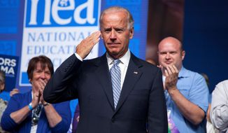** FILE ** Vice President Joseph R. Biden salutes after arriving to speak before the 2012 National Educational Association's annual meeting on Tuesday, July 3, 2012, in Washington. (Associated Press)