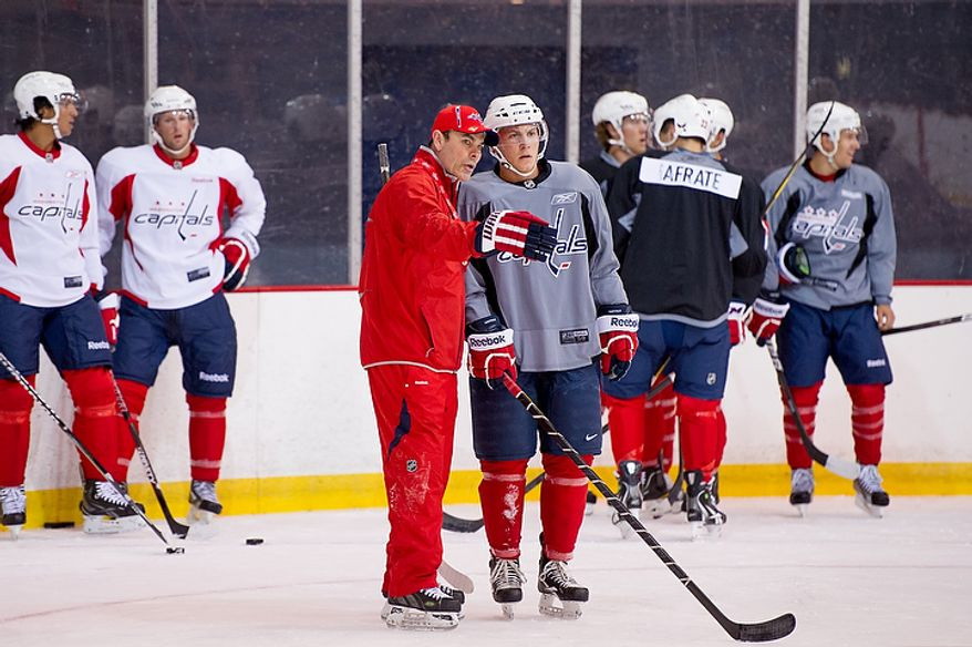 Washington Capitals head coach Adam Oates (center left) gives instructions to Thomas Di Pauli before a drill on the first day of practice at the annual development camp at the Kettler Capitals Iceplex in Arlington on Monday, July 9, 2012. (Andrew Harnik/The Washington Times)