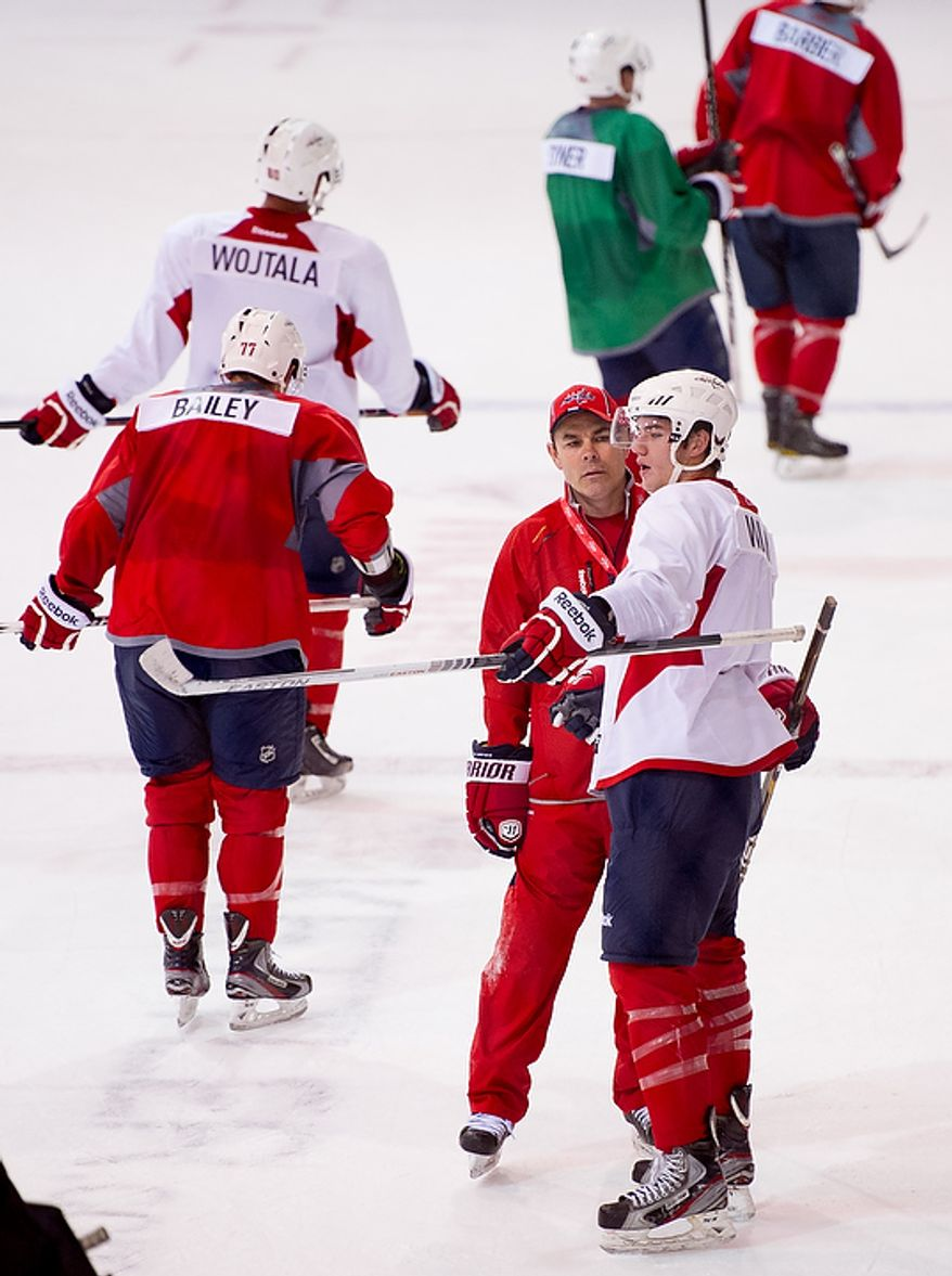 Washington Capitals head coach Adam Oates (second from right) talks with Tom Wilson (right) between drills on the first day of practice at the annual development camp at the Kettler Capitals Iceplex in Arlington on Monday, July 9, 2012. (Andrew Harnik/The Washington Times)