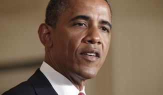 President Obama speaks before signing the Surface Transportation Bill during a ceremony in the East Room of the White House in Washington on Friday, July 6, 2012. (AP Photo/Pablo Martinez Monsivais)