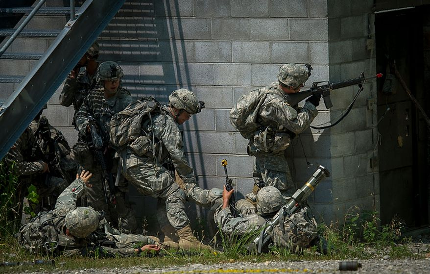 The Sapper candidates navigate a firefight on a mission, during another day of Sapper School training at U.S. Army Maneuver Support Center (MANSCEN) and Fort Leonard Wood in Fort Leonard Wood, Mo., Wednesday, June 27, 2012. (Rod Lamkey Jr./The Washington Times)