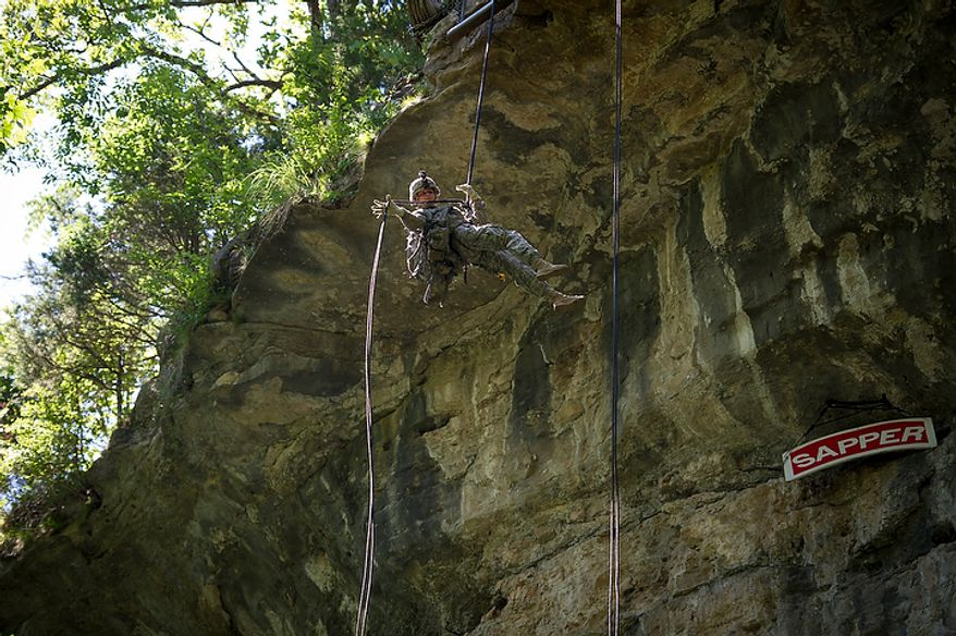 Sapper candidate and Army Captain Stephanie Godman repels down the side of a cliff during another day of Sapper School training at U.S. Army Maneuver Support Center (MANSCEN) and Fort Leonard Wood in Fort Leonard Wood, Mo., Tuesday, June 26, 2012. (Rod Lamkey Jr./The Washington Times)