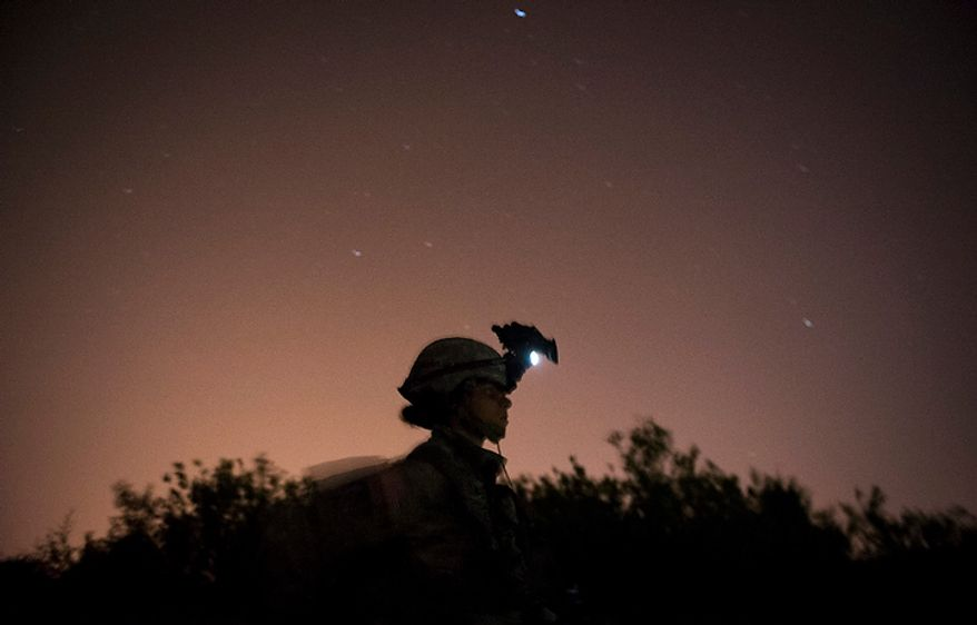 Sapper candidate and Army Captain Stephanie Godman is silhouetted by a star-filled night sky after taking part in a night time ambush during another day of Sapper School training at U.S. Army Maneuver Support Center (MANSCEN) and Fort Leonard Wood in Fort Leonard Wood, Mo., Monday, June 25, 2012. (Rod Lamkey Jr./The Washington Times)