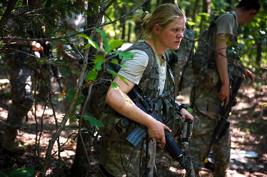 Sapper candidate and Army Captain Aston Armstrong carries her weapon as she and other prepare to move from the woods after planning their next mission during another day of Sapper School training at U.S. Army Maneuver Support Center (MANSCEN) and Fort Leonard Wood in Fort Leonard Wood, Mo., Monday, June 25, 2012. (Rod Lamkey Jr./The Washington Times)