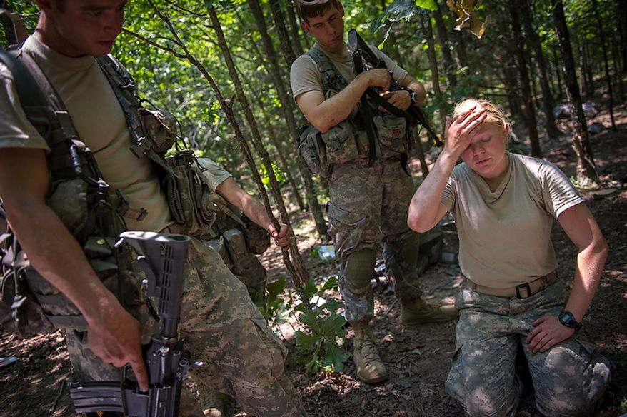 With temperatures in the triple digits, Sapper candidate and Army Captain Aston Armstrong (right) wipes the sweat from her face as she confers with Army SSG Rock Richardson (left) and Army Captain Pablo Diaz (center) as she prepares her platoon for their next mission during another day of Sapper School training at U.S. Army Maneuver Support Center (MANSCEN) and Fort Leonard Wood in Fort Leonard Wood, Mo., Monday, June 25, 2012. (Rod Lamkey Jr./The Washington Times)