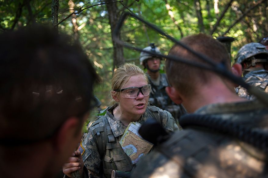 Sapper candidate and Army Captain Aston Armstrong gives directions to her platoon as they make their way into the thick woods for their next mission to detonate explosives, during another day of Sapper School training at U.S. Army Maneuver Support Center (MANSCEN) and Fort Leonard Wood in Fort Leonard Wood, Mo., Monday, June 25, 2012. (Rod Lamkey Jr./The Washington Times)
