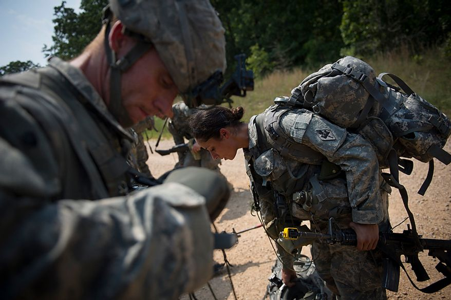 Sapper candidate and Army Captain Stephanie Godman (right) and the rest of the platoon board a waiting truck to be transported to a site for the next mission during another day of Sapper School training at U.S. Army Maneuver Support Center (MANSCEN) and Fort Leonard Wood in Fort Leonard Wood, Mo., Monday, June 25, 2012. (Rod Lamkey Jr./The Washington Times)