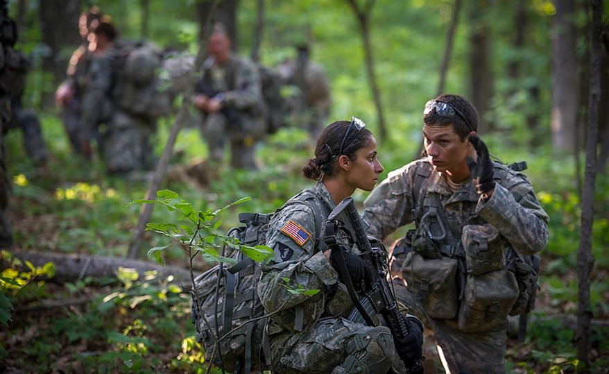 "Sapper candidate and Army Captain Stephanie Godman (left) confers with her ""Battle Buddy"" Sapper candidate and National Guard Staff Sargent Anthony Hughes, as they plan for a mission during another day of Sapper School training at U.S. Army Maneuver Support Center (MANSCEN) and Fort Leonard Wood in Fort Leonard Wood, Mo., Tuesday, June 26, 2012. (Rod Lamkey Jr./The Washington Times)"