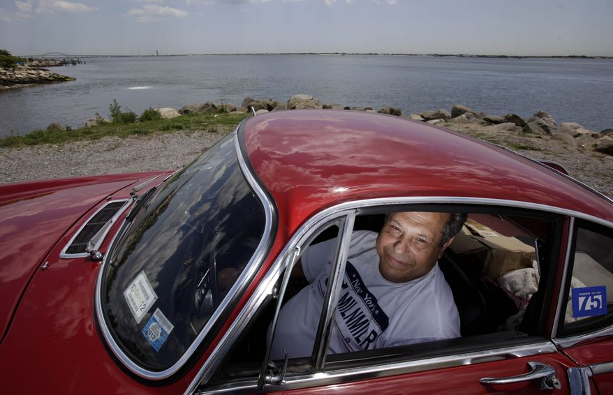 Irv Gordon sits July 2, 2012 in his Volvo P1800 in Babylon, N.Y. Gordon's car already holds the world record for the highest recorded mileage on a car and he is less than 40,000 miles away from passing three million miles on the Volvo. (Associated Press)