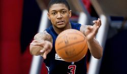 Wizards rookie Bradley Beal averaged 14.8 points in his only season at Florida. As the shooting guard, he's expected to run the floor with point guard John Wall. Beal received a taste of the NBA game during minicamp at Verizon Center (below). (Ryan M.L. Young/The Washington Times)