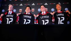 D.C United president Kevin Payne, along with co-owners Erick Thohir, Jason Levien and Will Chang greet members of the media at an introductory news conference Tuesday. One of the group's primary goals is to establish a permanent home for the MLS franchise. United have played at aging RFK Stadium since their inception in 1996. (Ryan M.L. Young/The Washington Times)