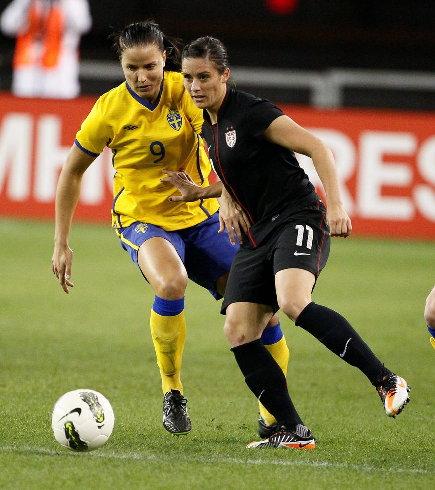 Ali Krieger (right) had hoped to be about 90 percent healthy by the end of June, but when the Olympic roster was set May 27, her chances of competing were over. (Associated Press)