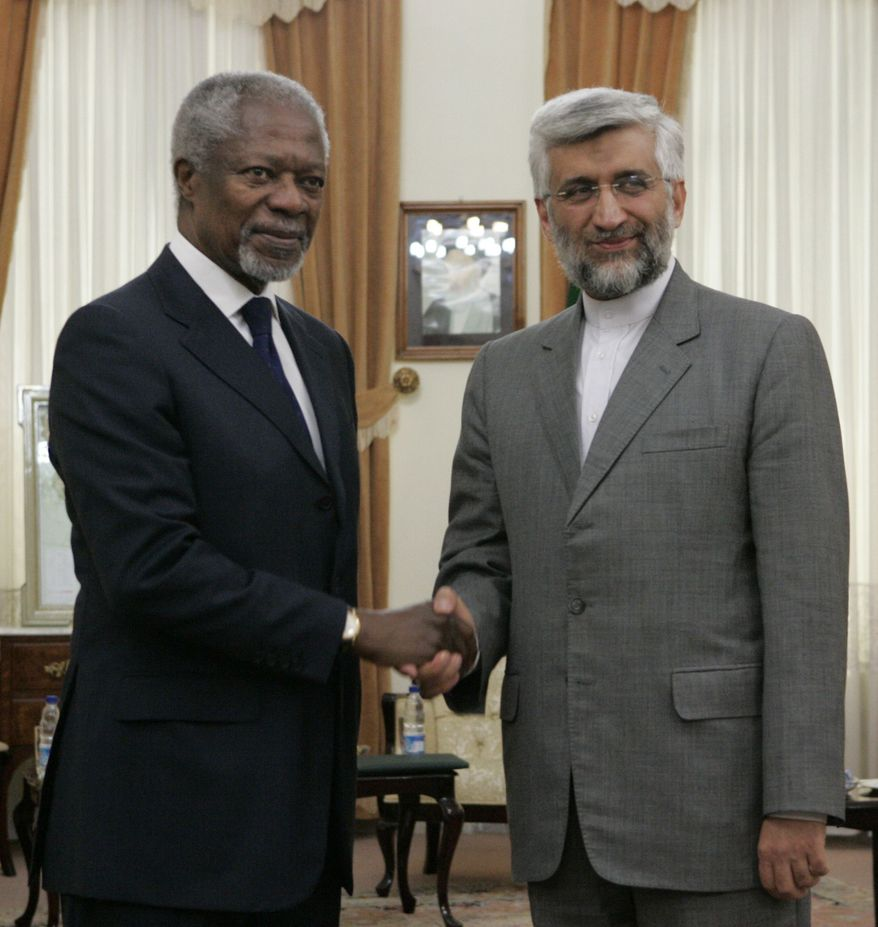 "International envoy Kofi Annan, left, shakes hands with secretary of Iran's Supreme National Security Council, Saeed Jalili, as he arrives for a meeting, in Tehran, Iran, Tuesday, July 10, 2012. Annan said Tuesday that Iran must be ""part of the solution"" to the bloody crisis in its close ally Syria, and that the Tehran has offered its support to end the conflict. (AP Photo/Vahid Salemi)"