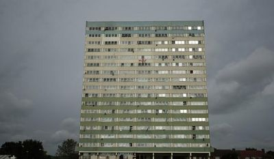 On Tuesday, July 10, 2012, residents of the Fred Wigg Tower in Leytonstone in east London lost a court suit that would have prevented missiles being placed atop the building during the Olympic Games. (AP Photo/Matt Dunham)