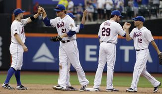 Under MLB's new schedule format, the New York Mets will only play the New York Yankees three or four times in their interleague rivalry games.  (AP Photo/Frank Franklin II)