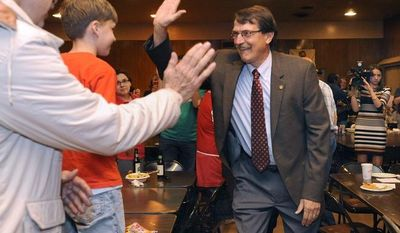 Democratic state Senate candidate John Lehman gives a high-five to a young supporter as he arrives for an election-night party at the Racine Labor Center in Racine, Wis., on Tuesday, June 5, 2012. (AP Photo/Scott Anderson, Journal Times)