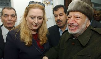 ** FILE ** Palestinian leader Yasser Arafat and his wife, Suha, hold hands before his departure from his compound in the West Bank town of Ramallah in October 2004. (AP Photo/Palestinian Authority, Hussein Hussein)