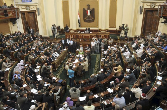 Egyptian Parliament Speaker Saad el-Katani presides over a brief session of parliament, the first since the country's high court ruled the chamber unconstitutional, in Cairo on Tuesday
