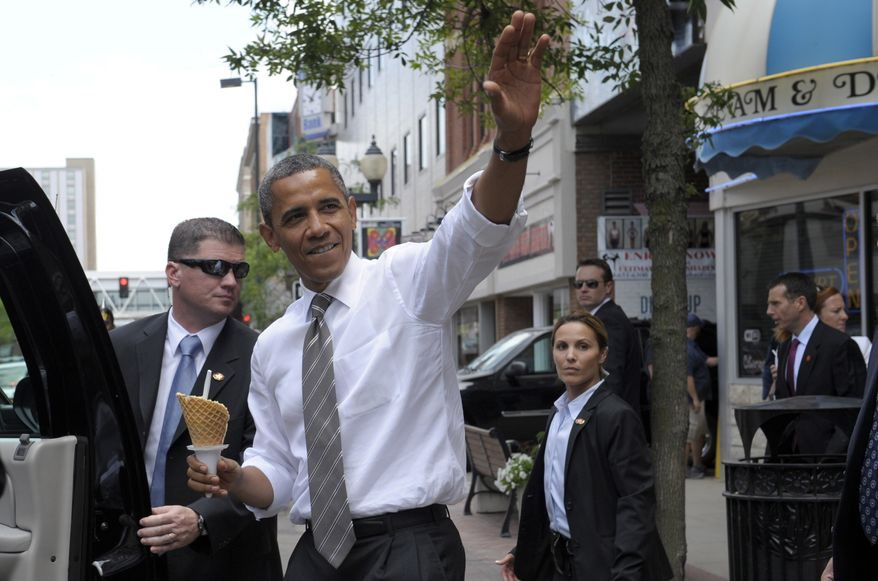 President Obama heads to his car July 10, 2012, after getting ice cream at Deb's Ice Cream & Deli in Cedar Rapids, Iowa. (Associated Press)
