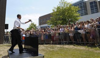 President Barack Obama speaks to the overflow crowd before an event on middle class tax relief at a campaign event inside the Kirkwood Community College Recreation Center in Cedar Rapids, Iowa, Tuesday, July 10, 2012. (AP Photo/Susan Walsh)