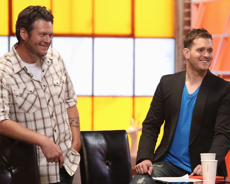"""Crooner Michael Buble (right) will advise country star Blake Shelton's team of contestants on NBC's """"The Voice."""" (Associated Press)"""