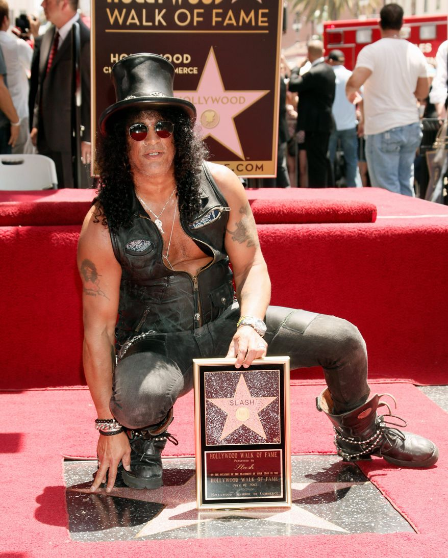 Slash shows his star at the Hollywood Walk of Fame ceremony on Tuesday in Los Angeles. The legendary guitarist was a member of Guns N' Roses. (Associated Press)