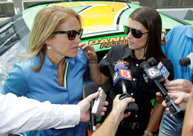 "Katie Couric (left) and race-car driver Danica Patrick are interviewed Tuesday at the Indianapolis Motor Speedway after Patrick took Ms. Couric for a ride in a two-seat race car. ""I was nervous at first, but I had a lot of fun,"" Ms. Couric said. (Associated Press)"
