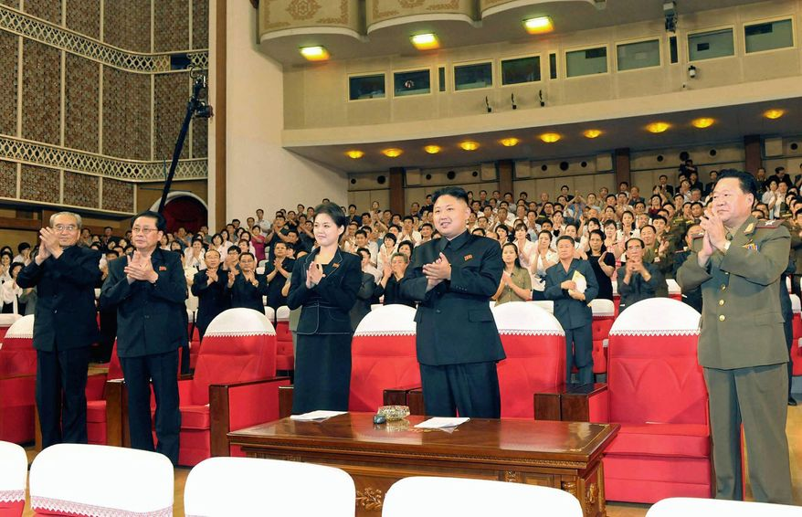 The mystery woman by North Korean leader Kim Jong-un's side at a concert in Pyongyang this month is driving international speculation about her identity. South Korean media have published various theories about who she might be. One says it is Mr. Kim's sister, another posits that it is a former pop singer and yet another says it could be his wife, since little is ever revealed about the private lives of the country's leaders. (Korean Central News Agency via Associated Press)
