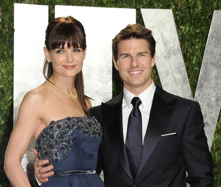 FILE - In this Feb. 26, 2012 file photo, actors Tom Cruise and Katie Holmes arrive at the Vanity Fair Oscar party, in West Hollywood, Calif. Cruise and Holmes have reached an agreement in their divorce case, according to her attorney. Holmes' attorney Jonathan Wolfe said in a statement Monday, July 9, that the case has been settled and an agreement was signed. Holmes filed for divorce less than two weeks ago, putting an end to the romance that began in 2005. The couple has a 6-year-old daughter, Suri. (AP Photo/Evan Agostini, File)